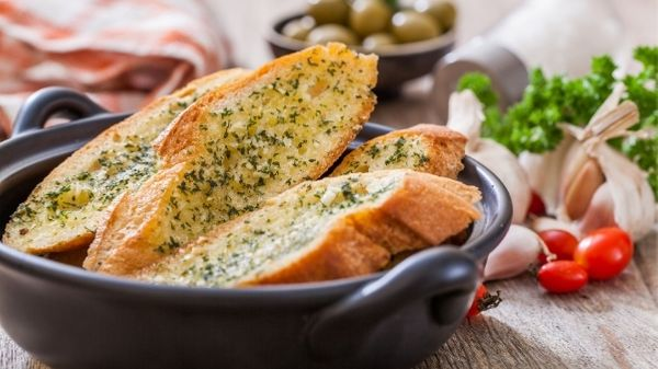 TO TAKE YOUR LASAGNA TO THE NEXT LEVEL SERVE IT WITH FRESHLY BAKED SLICES OF GARLIC BREAD.