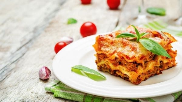 Learn how to make lasagna with this easy step-by-step recipe. Serves eight adult portions and all ingredients costs less than $20.